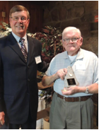 The 2014 LRTA Tourism Award was presented to FunSpot founder and owner, Bob Lawton, shown here with LRTA President Greg Goddard.